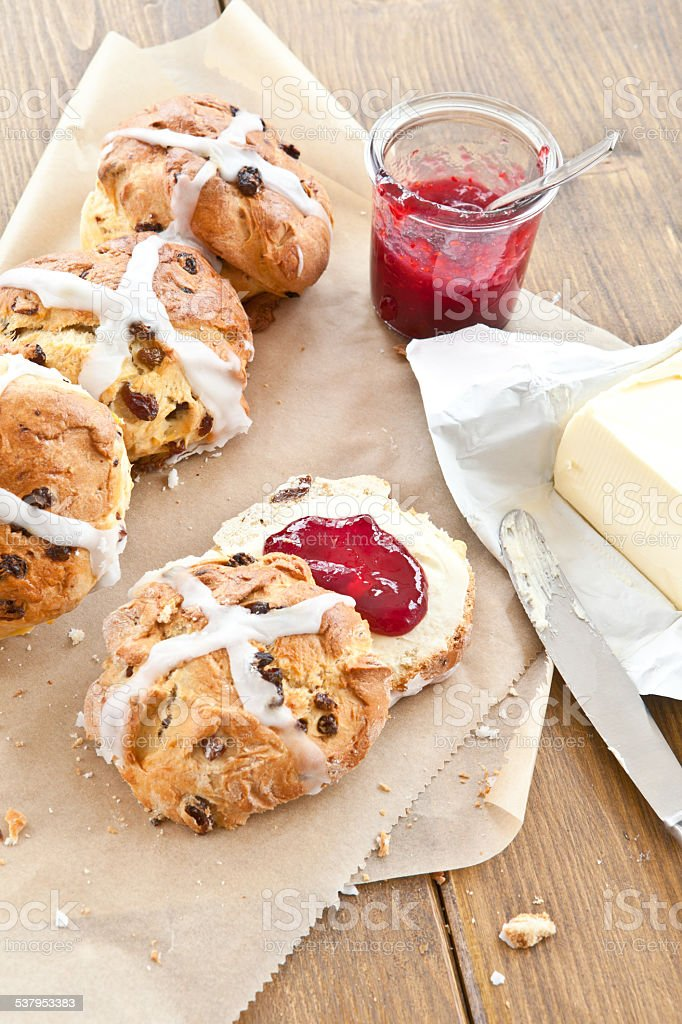 Hot cross buns with butter and jam stock photo