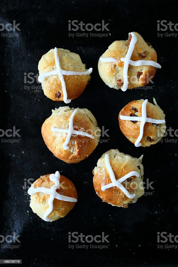 hot cross buns with the glaze on a baking sheet stock photo