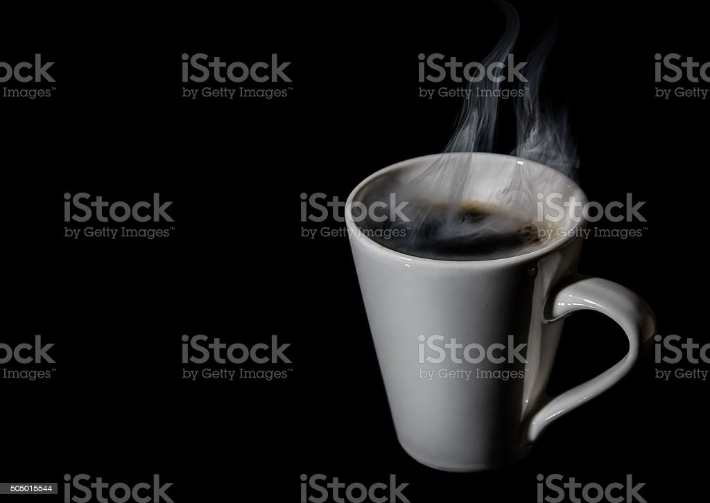 hot cup of coffee isolated on a black background stock photo
