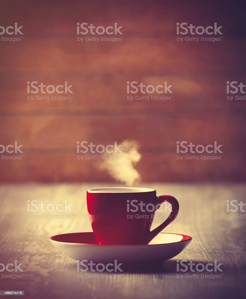 Hot Cup of coffee on wooden background. stock photo