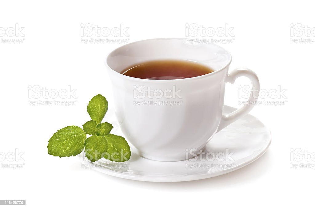 A hot cup of tea with mint on a saucer royalty-free stock photo