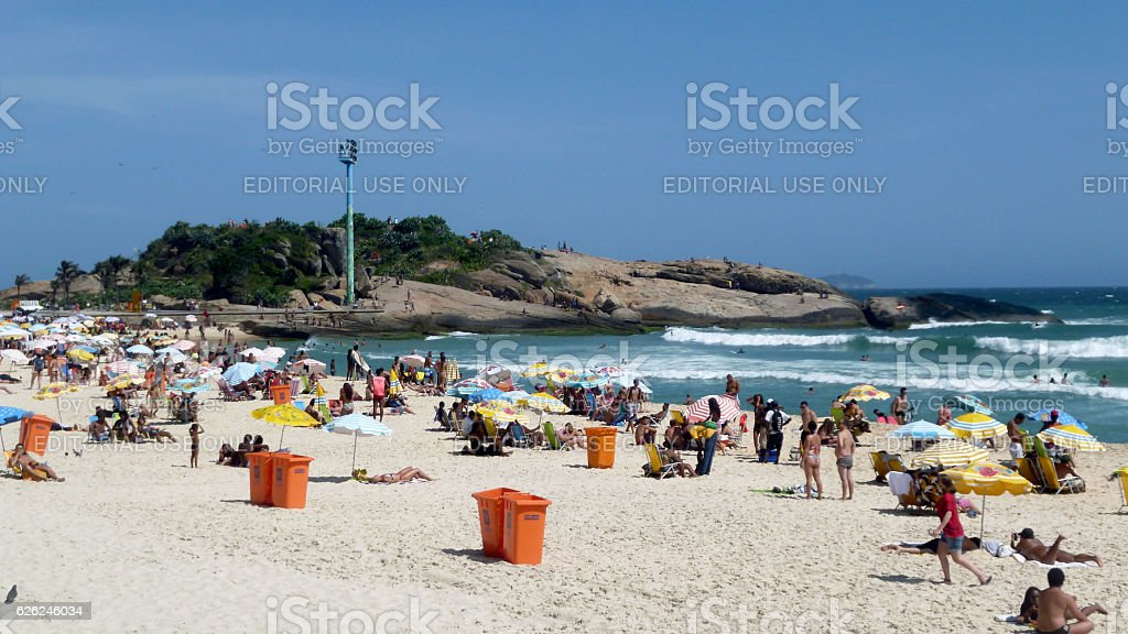 Hot day at Arpoador beach and stone stock photo