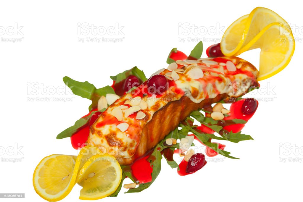 hot dish of grilled salmon on plate with sauce stock photo