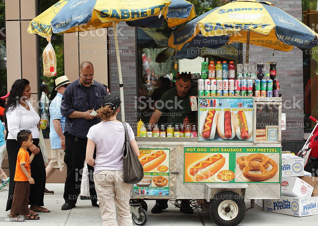 Hot dog and pretzel vendor street stall in NYC royalty-free stock photo