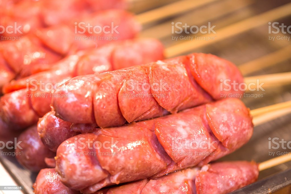 hot dog in bamboo stick for barbecue stock photo