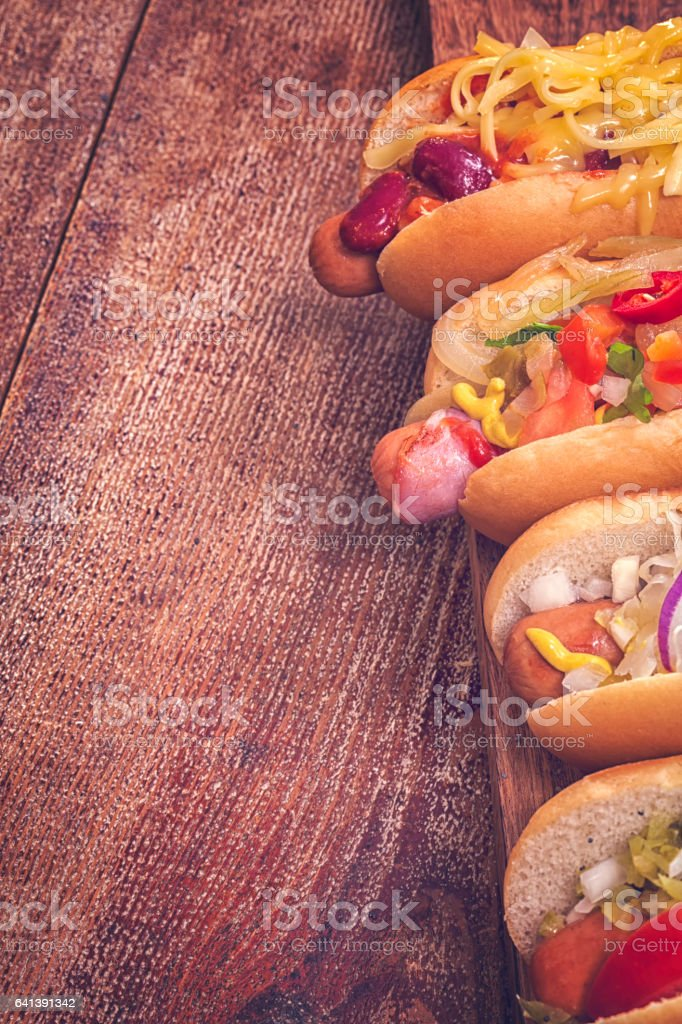 Hot Dog Variation on Wooden Board stock photo