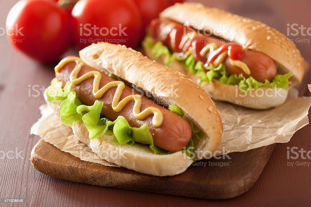 hot dog with ketchup mustard and lettuce stock photo