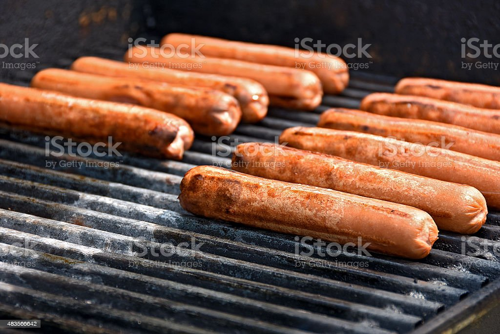hot dogs on grill stock photo