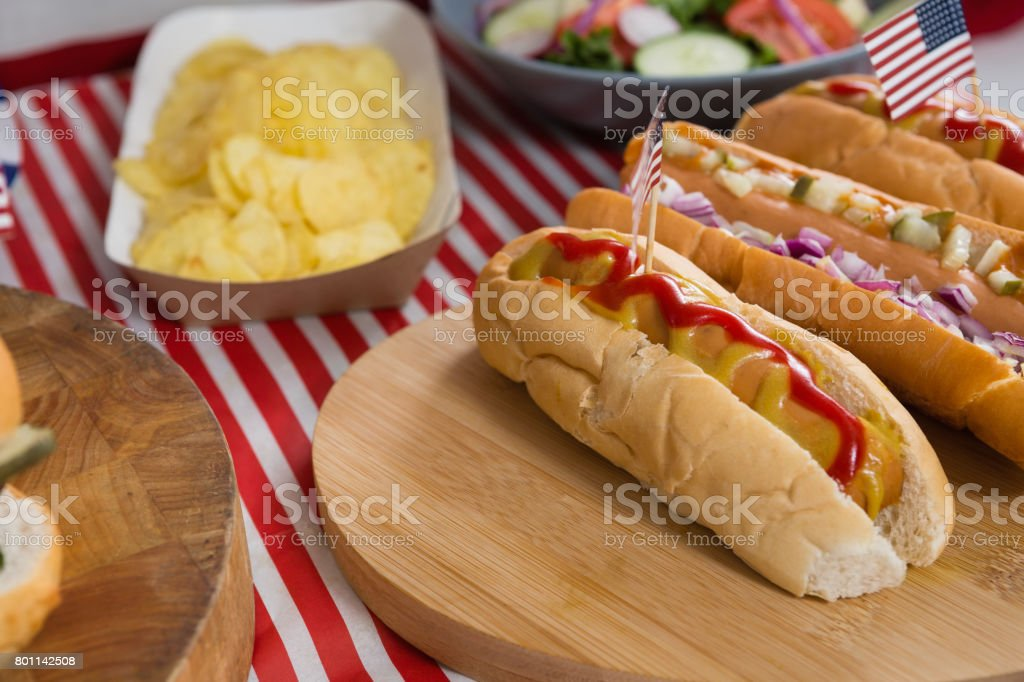 Hot dogs on wooden table with 4th july theme stock photo