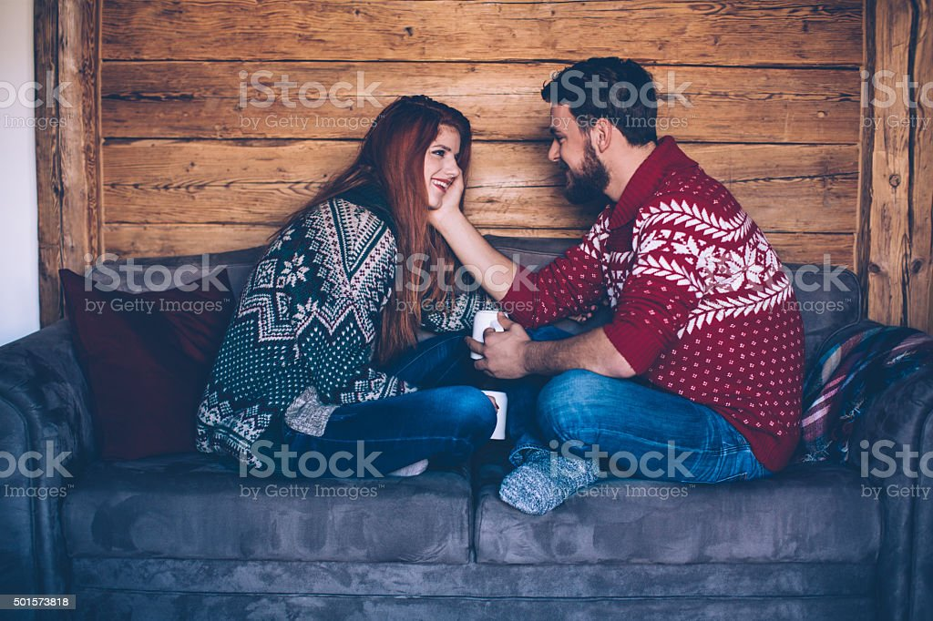 Hot drink and cozy sweater stock photo