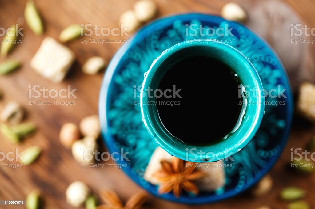 Hot drink with spices in authentic cup stock photo