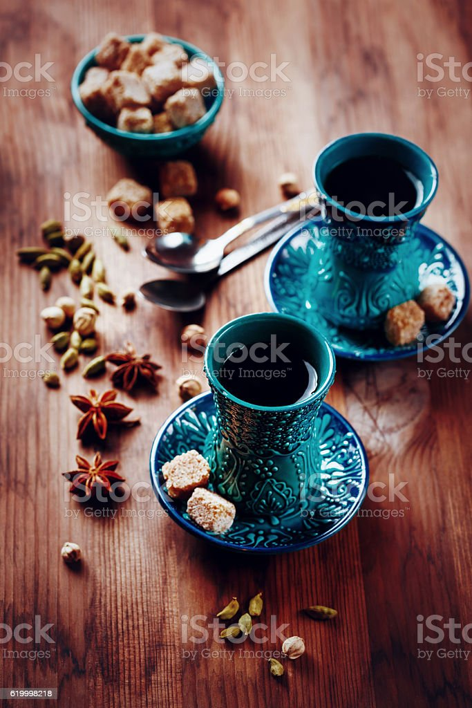 Hot drink with spices in authentic glasses stock photo