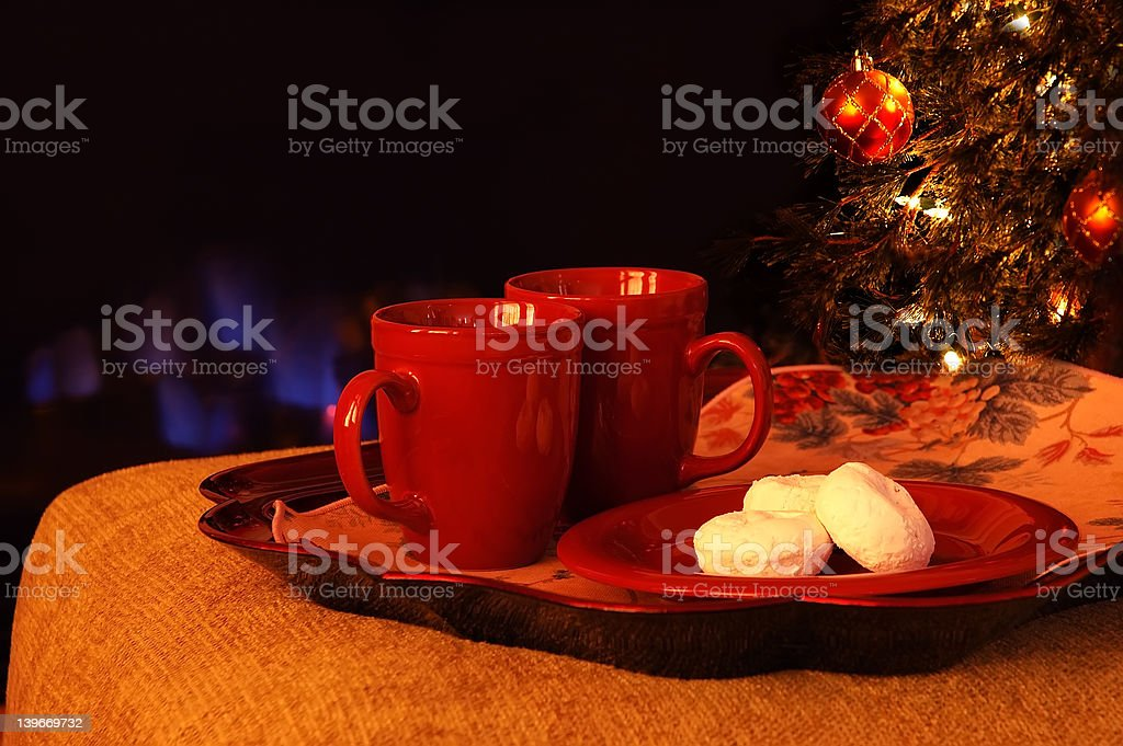 Hot Drinks and Powdered Sugar Donuts by the Fire royalty-free stock photo