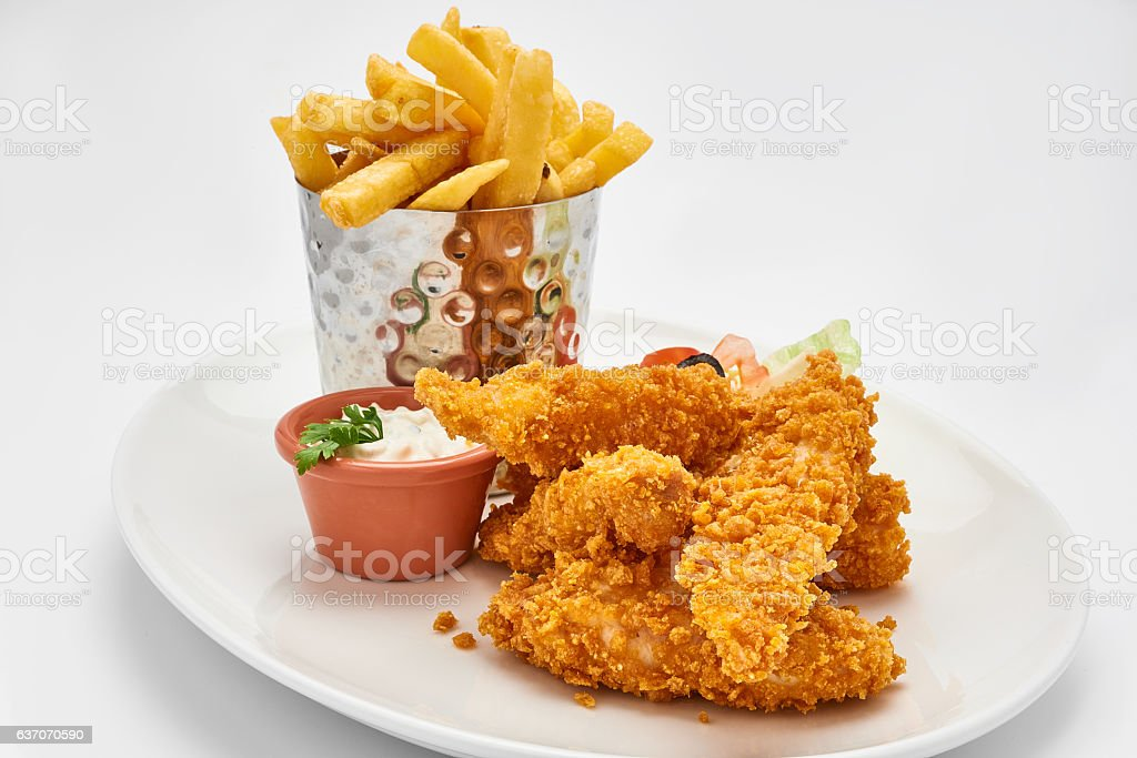 hot fried chicken wings in basket isolated on white background stock photo