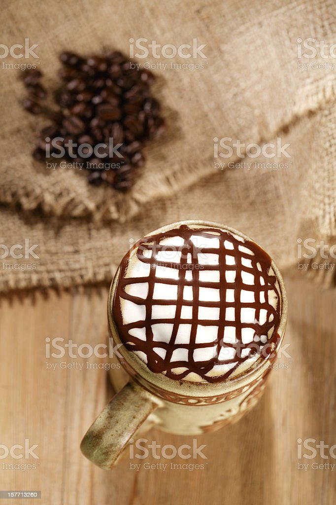 hot frothy  coffee cappuccino chocolate topping, in rustic style royalty-free stock photo