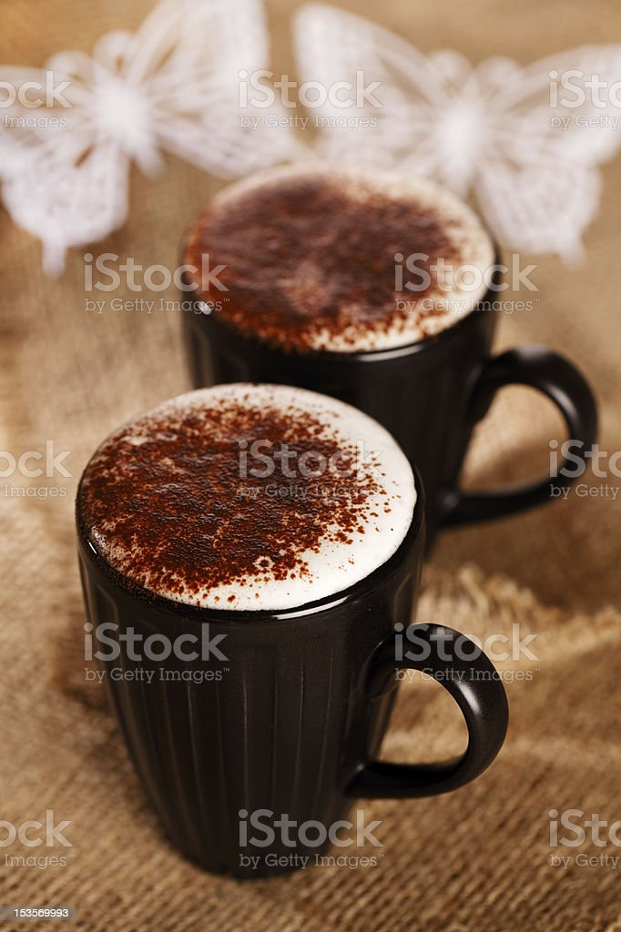hot frothy drink cappuccino chokolate dusted, white paper butter royalty-free stock photo