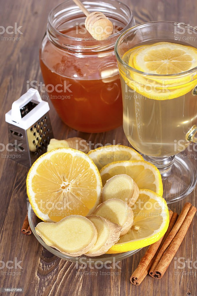 Hot ginger lemon tea, honey and cinnamon royalty-free stock photo