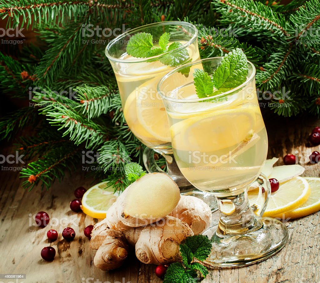 Hot ginger lemon tea in Christmas decoration with fir branches stock photo