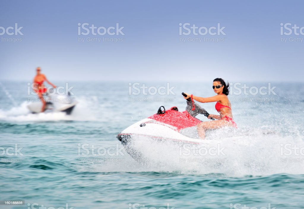 Hot Girls on Jet Skis / Waverunner in tropical Water stock photo