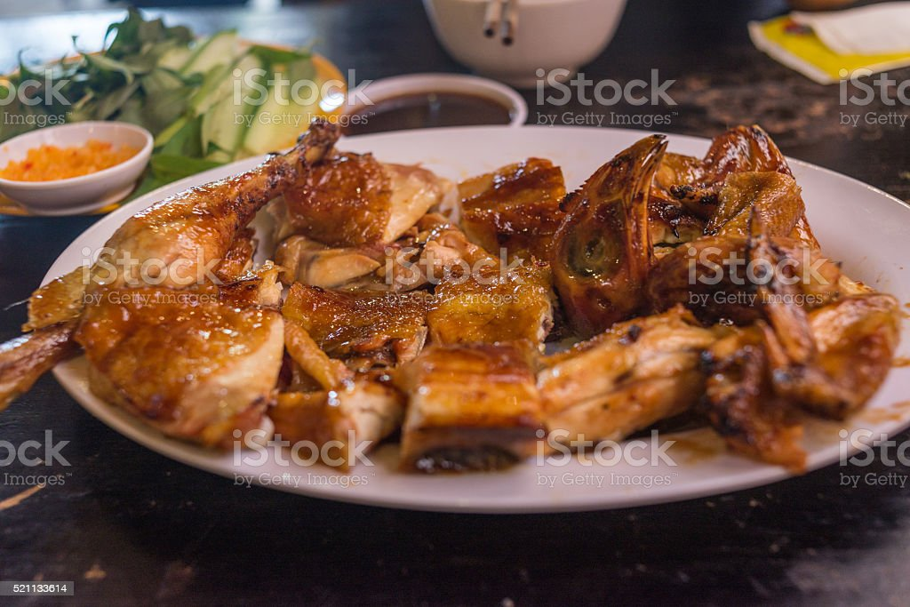 Hot grilled chicken and salad served in Asian restaurant stock photo