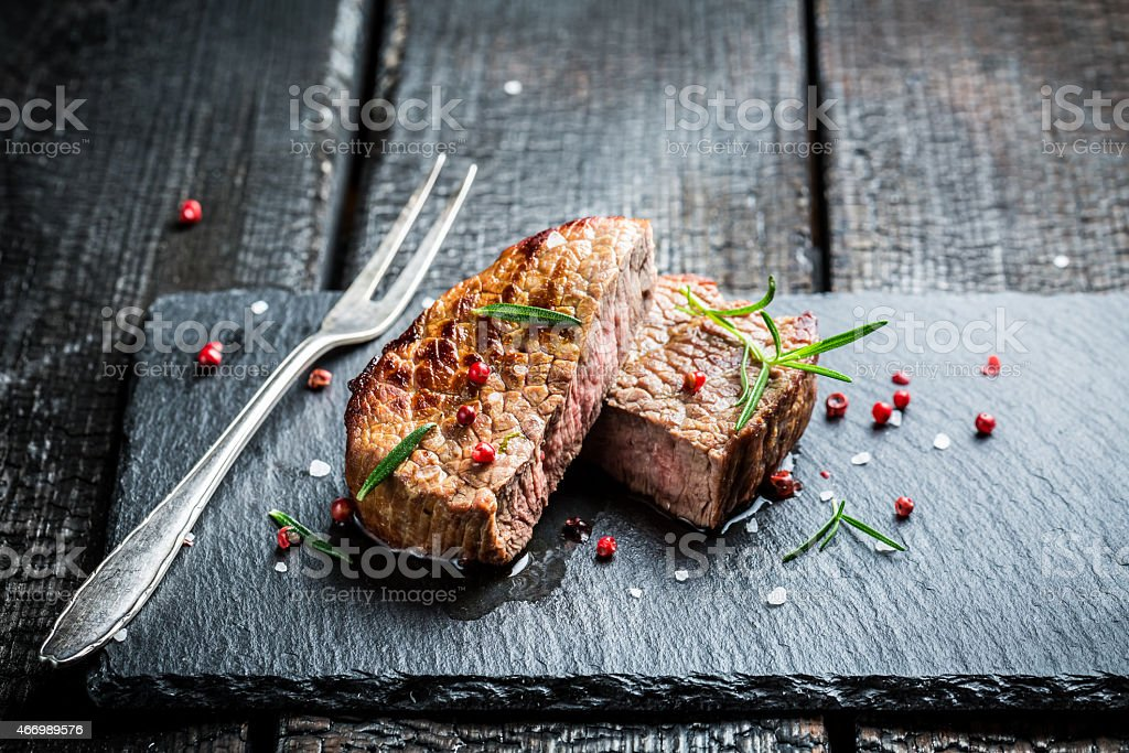 Hot grilled meat with fresh rosemary ready to eat stock photo