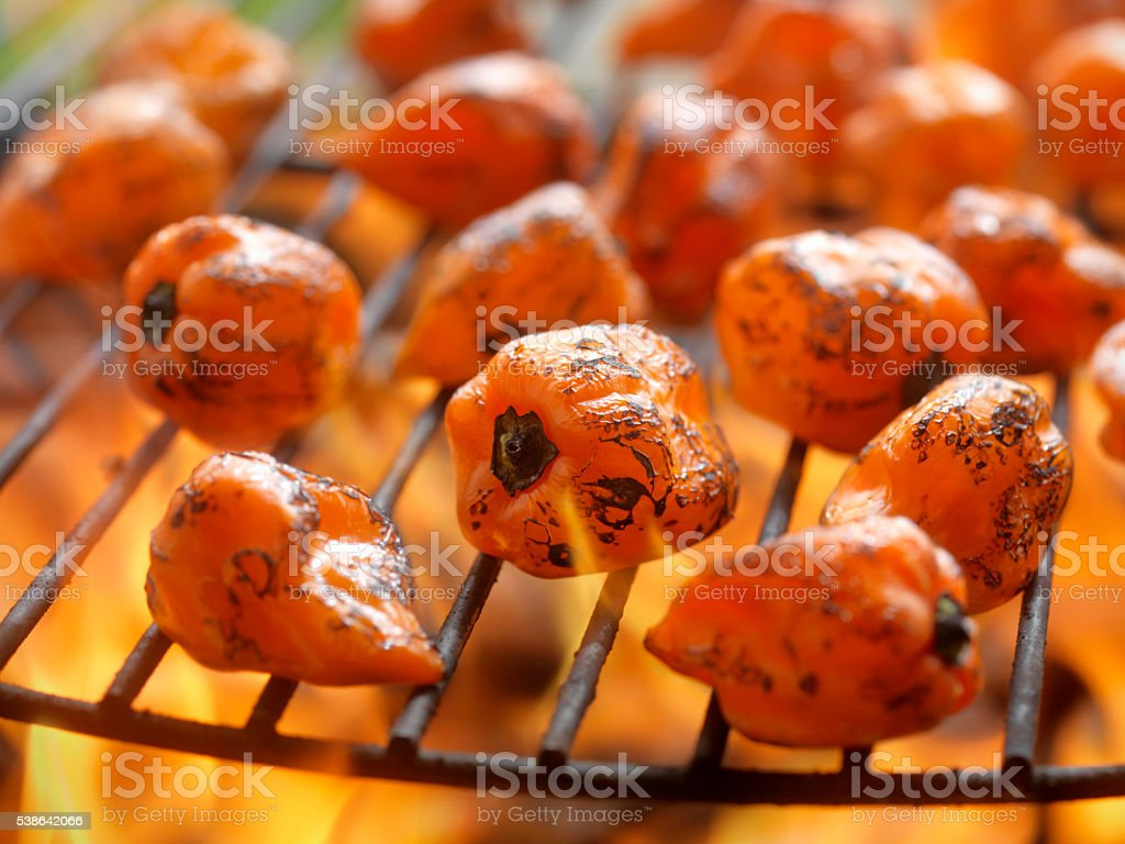 Hot Habanero Peppers on the BBQ stock photo