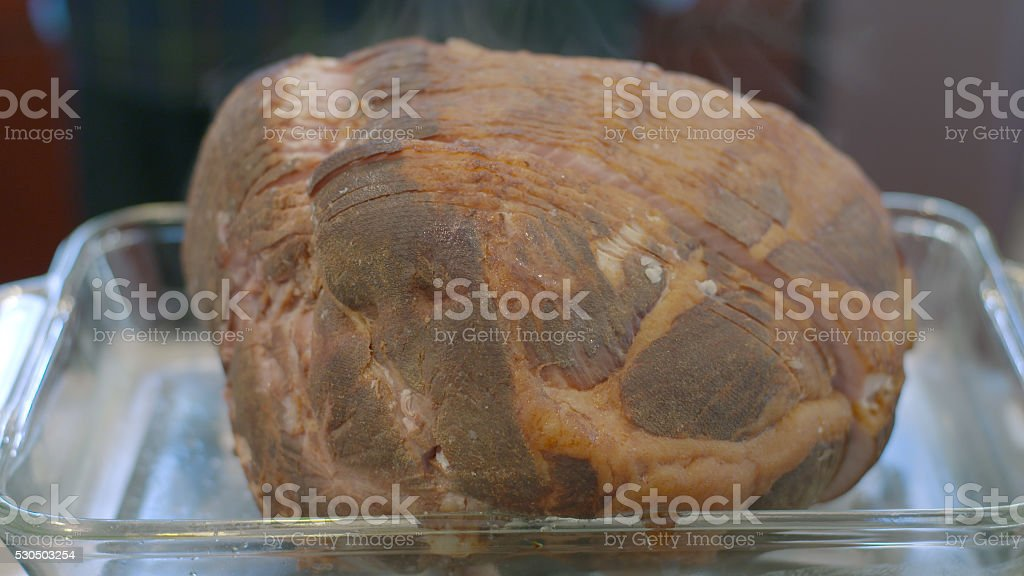 Hot Honey Ham Steaming Food in Glass Oven Pan stock photo