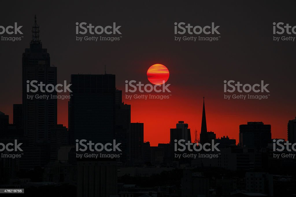Hot in the city with red sun royalty-free stock photo