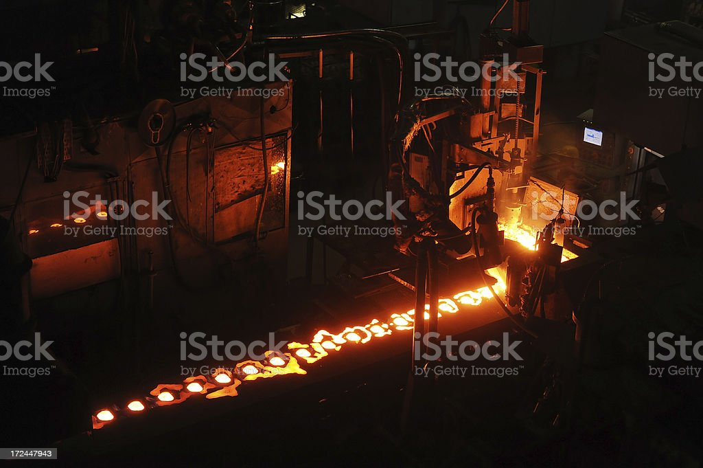 Hot iron in mill stock photo