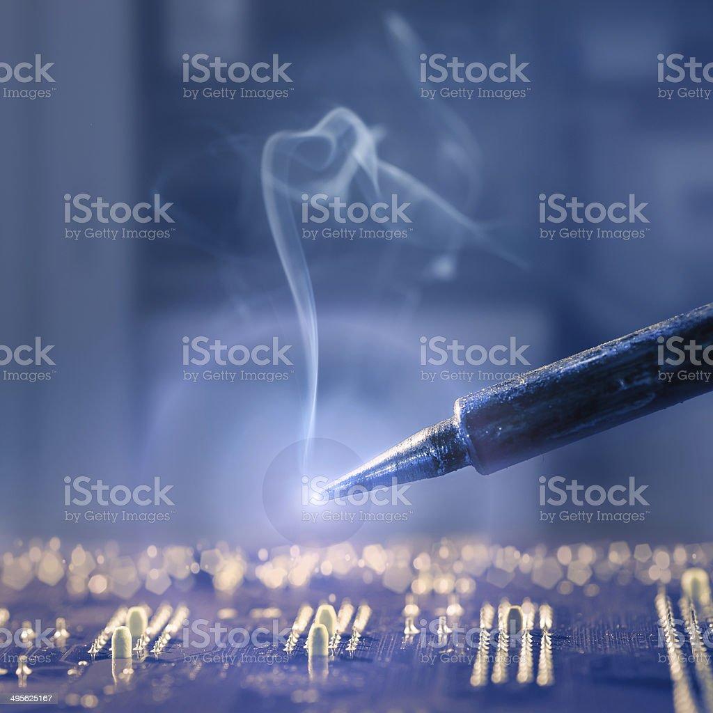 Hot iron solder stock photo