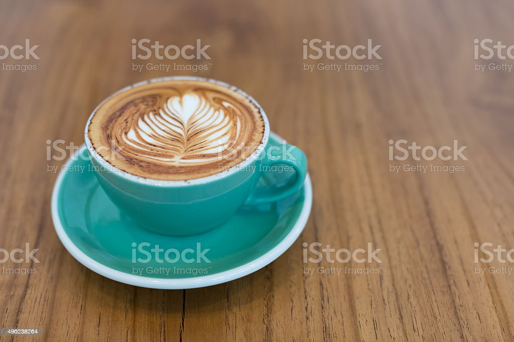 Hot latte coffee on green cup and  plate stock photo