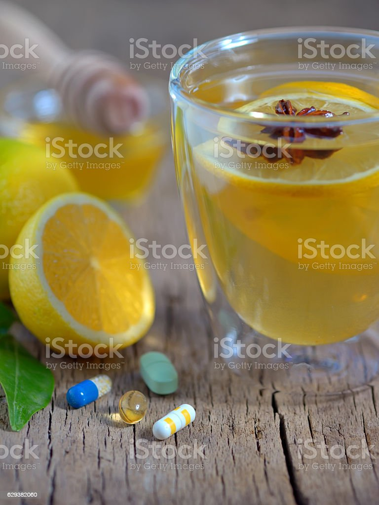Hot lemon tea and pills stock photo