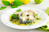 Hot lunch vapor sturgeon with lemon sauce and capers.