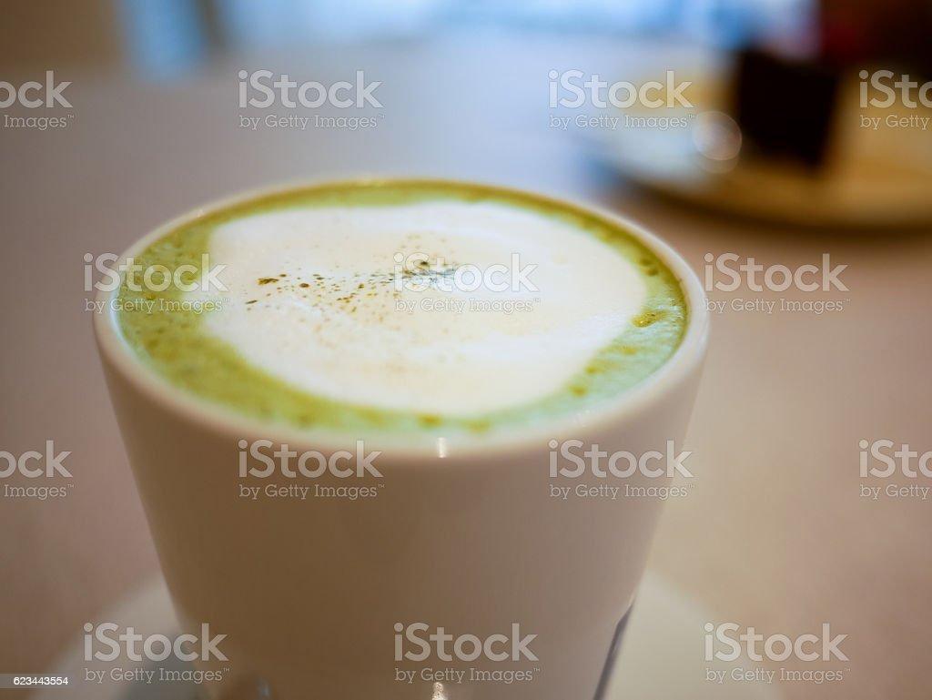 Hot macha green tea latte on a cup stock photo