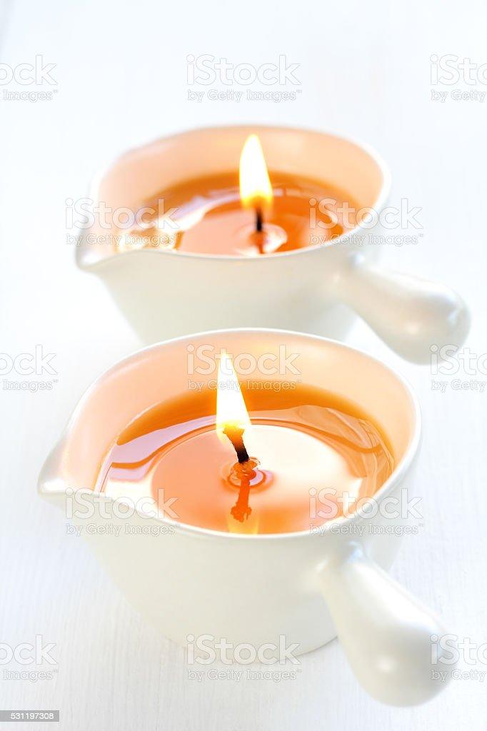 Hot massage candle. stock photo