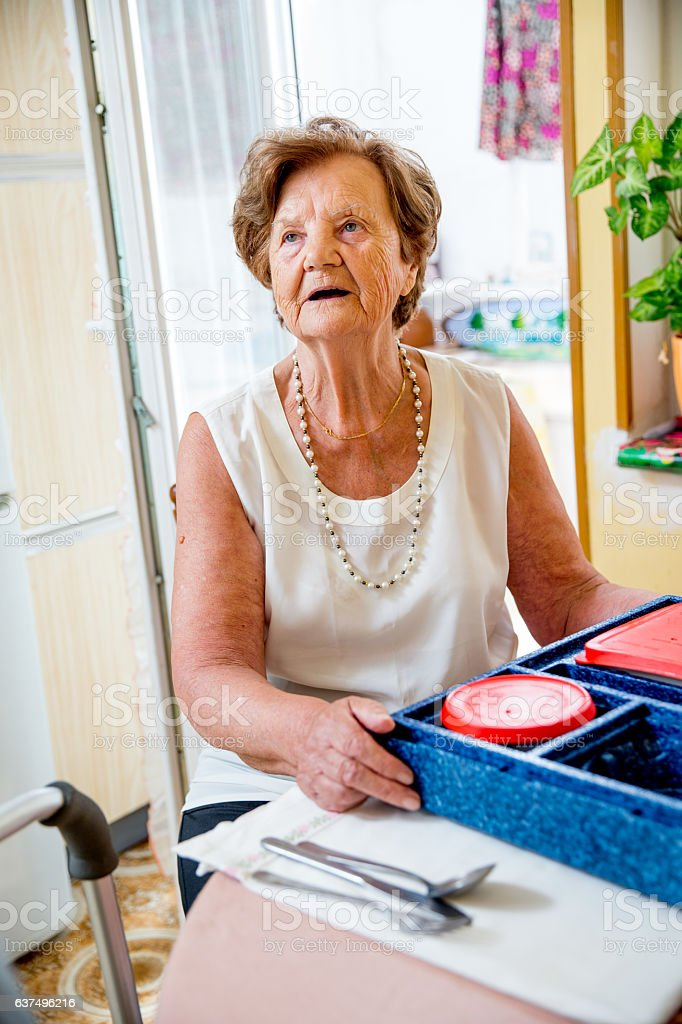 Hot Meal Delivery to an Elderly Woman at Home stock photo