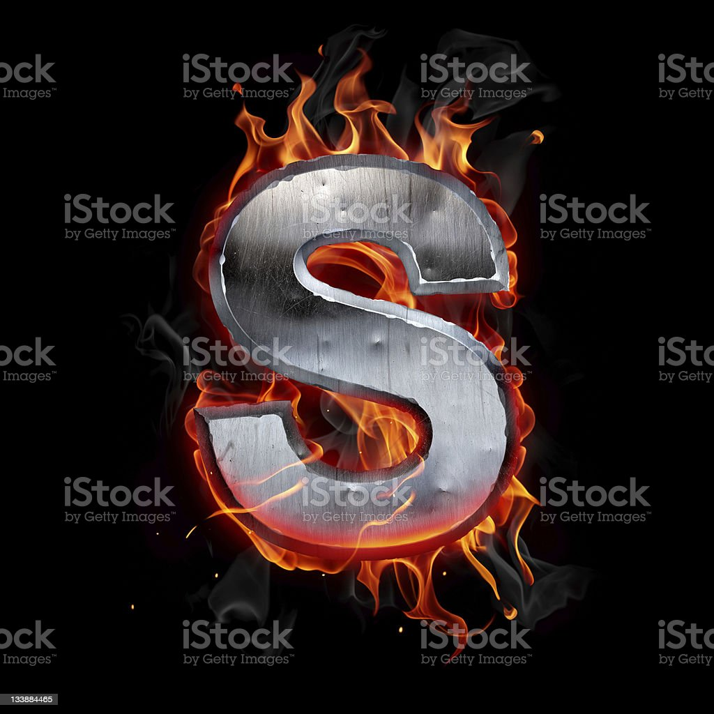 A hot metal letter S in flames royalty-free stock photo