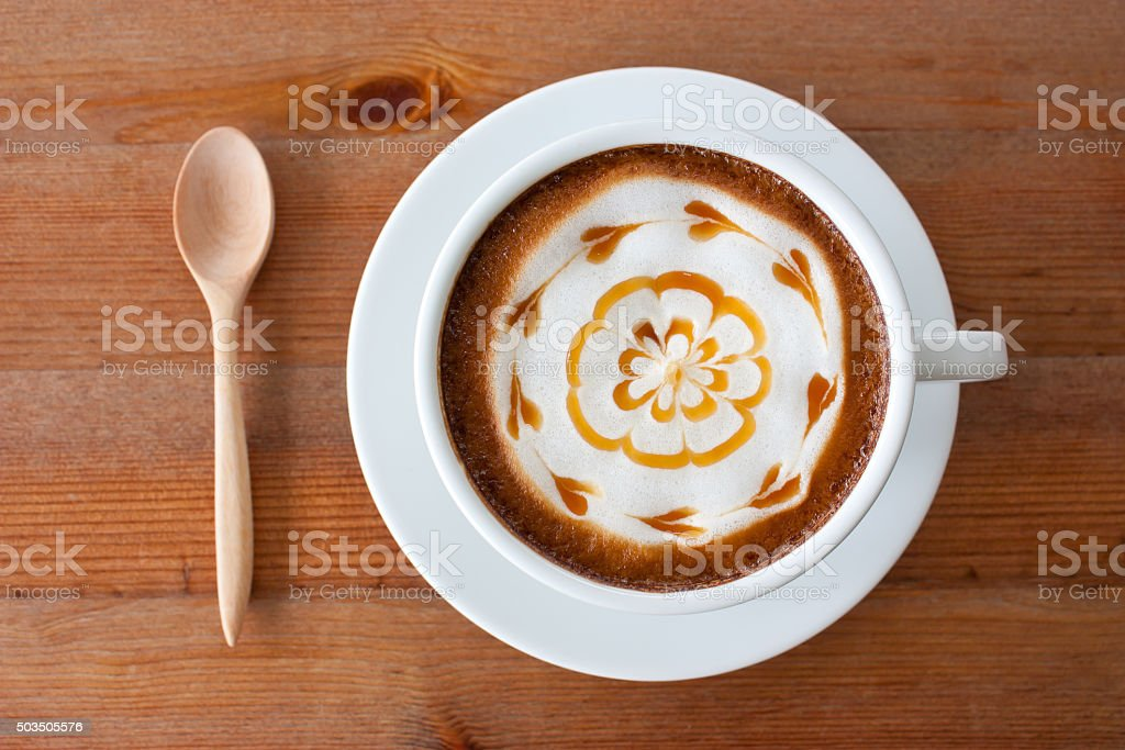 hot milk art coffee on wooden table stock photo