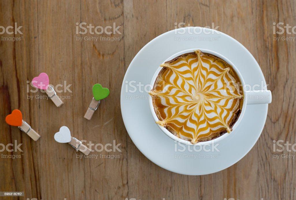 Hot milk latte art coffee on wooden table stock photo