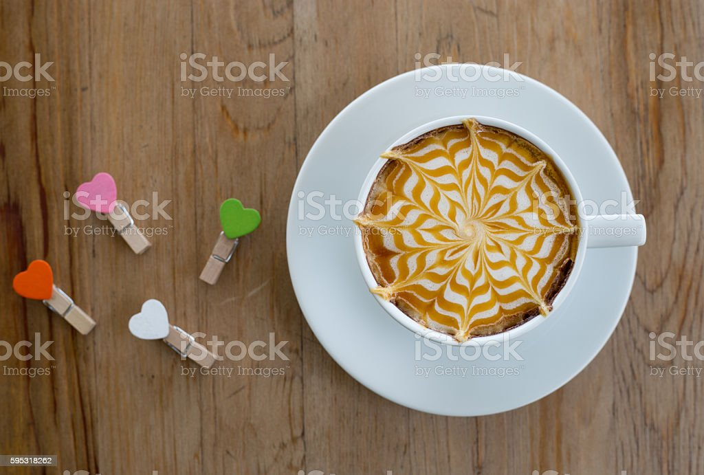 Hot milk latte art coffee on wooden table stock photo