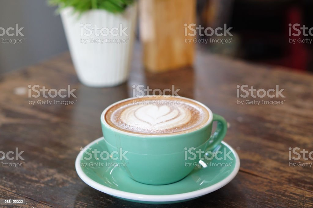 Hot Mocha - Closeup of a cup of coffee with milk and latte art on wooden table background. stock photo