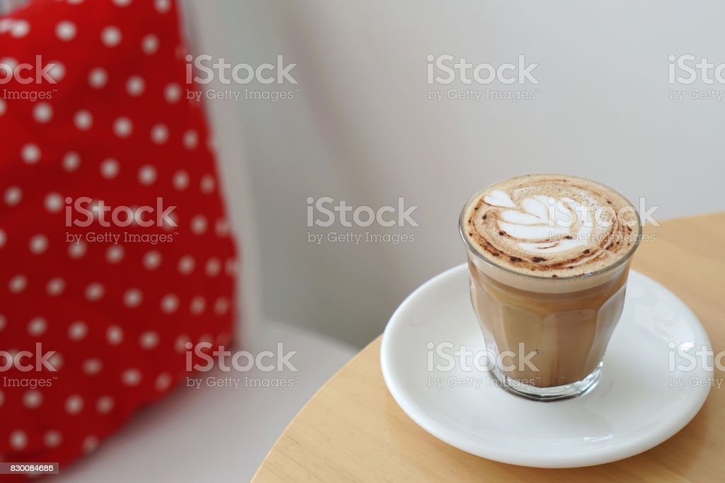 Hot Mocha - Closeup of a cup of coffee with milk and latte art on wooden table, Morning Breakfast. stock photo