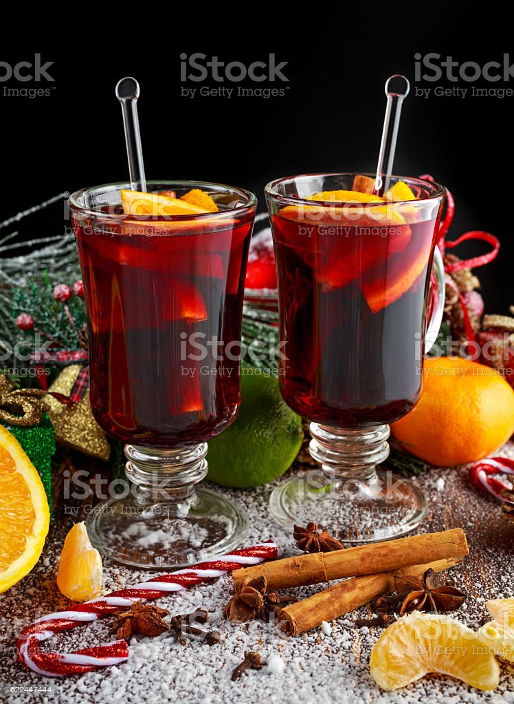 Hot Mulled wine with cinnamon sticks, orange, lime. christmas concept. stock photo