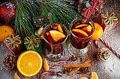 Hot Mulled wine with cinnamon sticks, orange, lime. christmas concept.