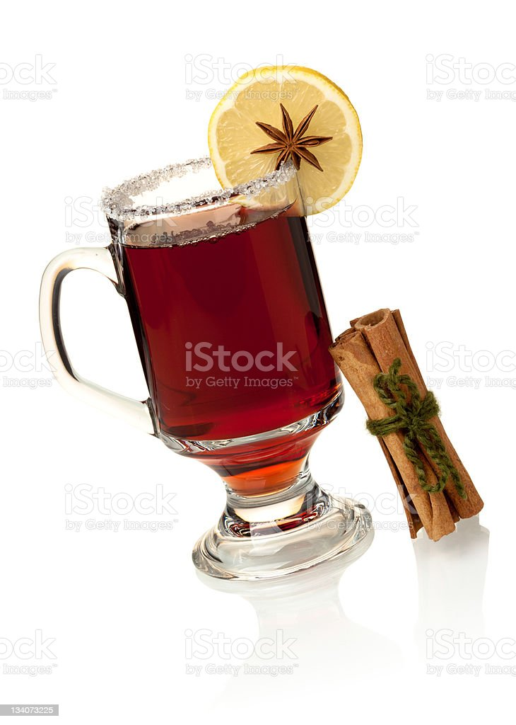 Hot mulled wine with lemon slice and cinnamon royalty-free stock photo