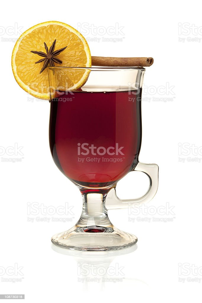 Hot mulled wine with orange slice, anise and cinnamon royalty-free stock photo