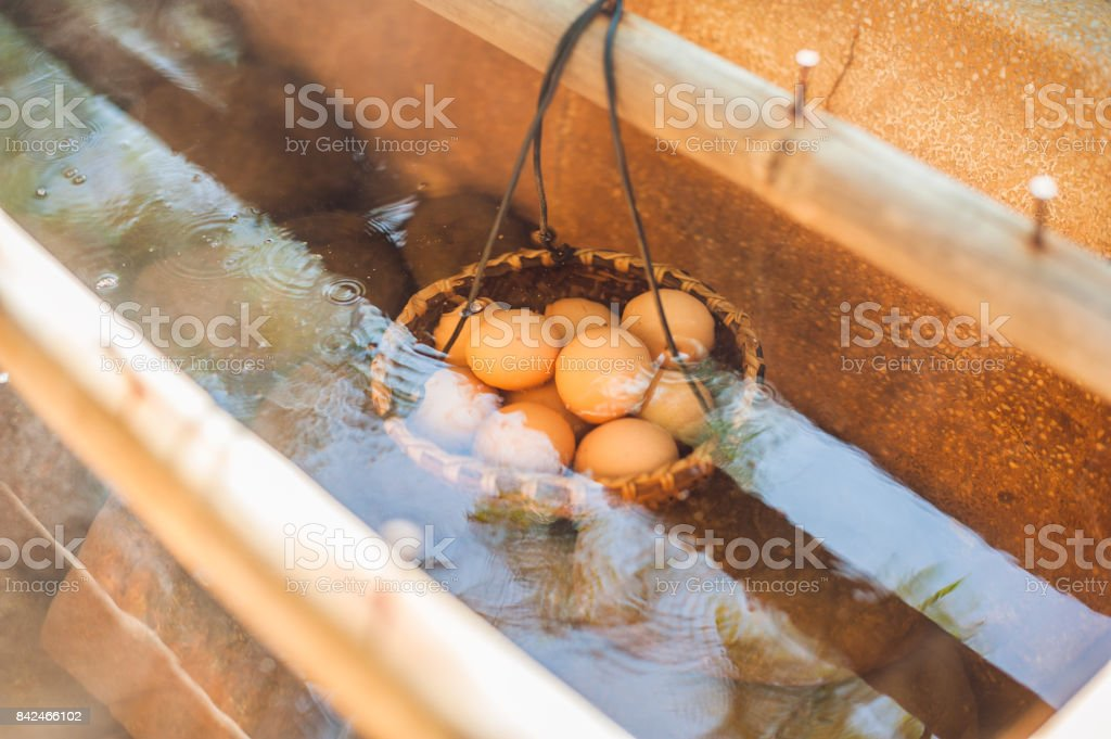 Hot natural underground thermal water is used to boil chicken eggs in some volcanic activity area. stock photo