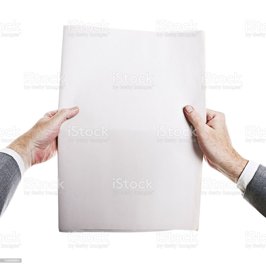 Hot off the press! Man's hands hold blank newspaper. royalty-free stock photo