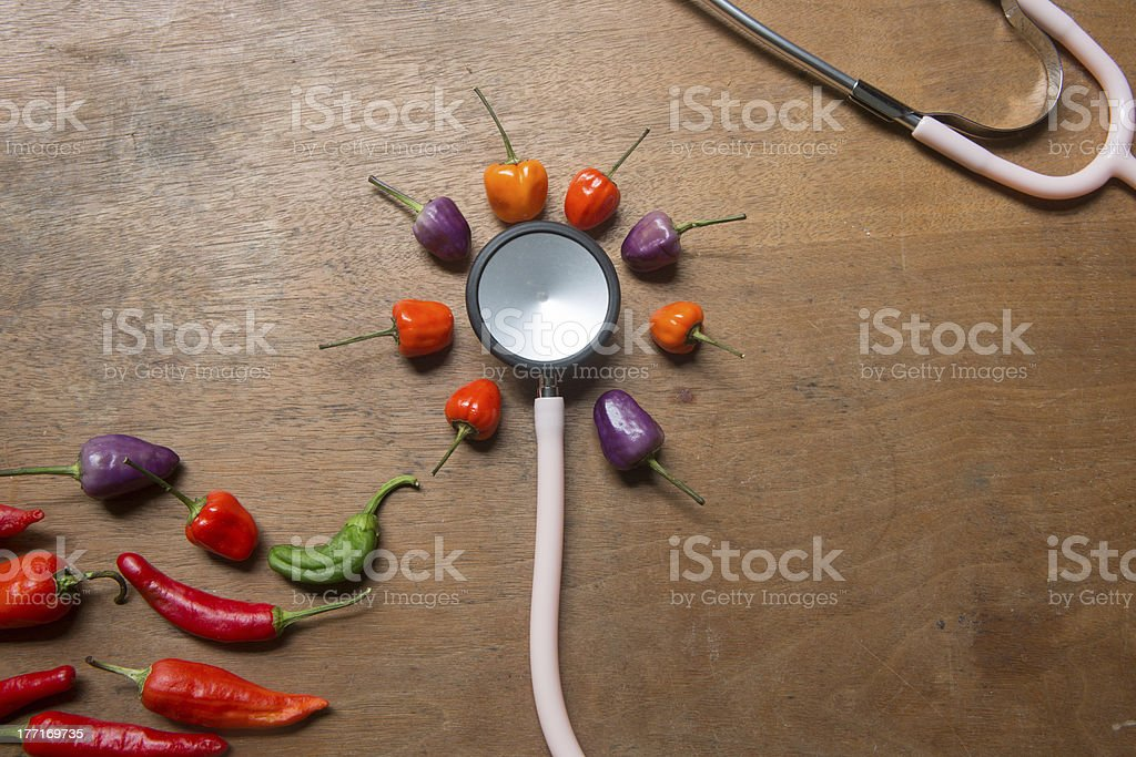 Hot Peppers and Stethoscope royalty-free stock photo