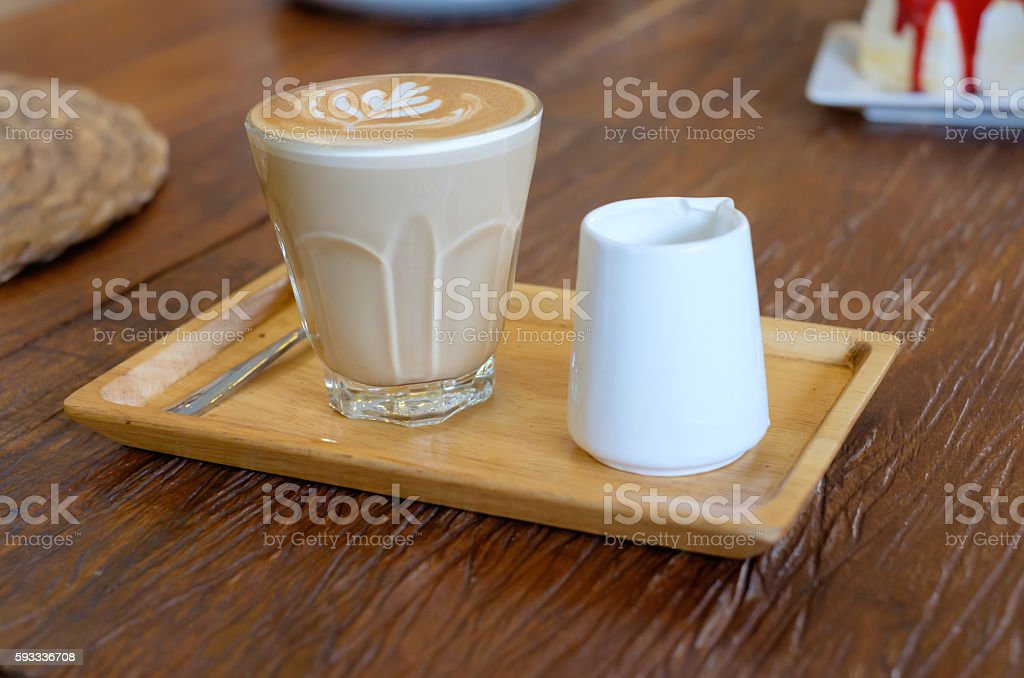 Hot Piccolo latte coffee serve with syrup in coffee shop stock photo